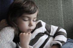 Sleeping girl. A young girl sleeping on a sofa Stock Photo