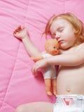 Sleeping girl Stock Images