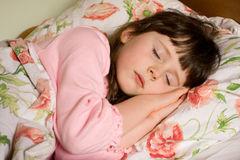 Sleeping girl. Portrait of cute caucasian girl child sleeping in her bed Royalty Free Stock Photo