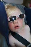 Sleeping girl. Little girl sleeping in car seat Stock Photography