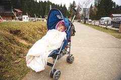 Sleeping Girl in Baby Carriage Stock Images