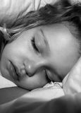 Sleeping girl black and white Stock Image
