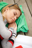 Sleeping girl with books outdoors Royalty Free Stock Images