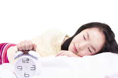 Sleeping girl with clock alarm Royalty Free Stock Photo