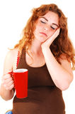 Sleeping girl with coffee. Royalty Free Stock Photo
