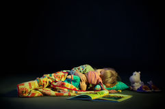 Sleeping girl cuddling doll Royalty Free Stock Photos