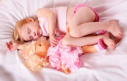 Sleeping girl with doll Royalty Free Stock Photography