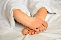 Sleeping girl feet Stock Photo