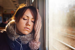 Sleeping girl with headphones in train Royalty Free Stock Photo