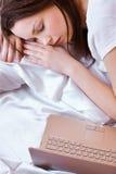 Sleeping girl with laptop Royalty Free Stock Photos