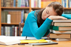 Sleeping girl in library Stock Images