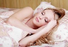 Sleeping girl in nightgown Stock Images