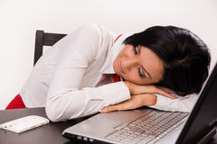 Sleeping  girl at office table Stock Photography