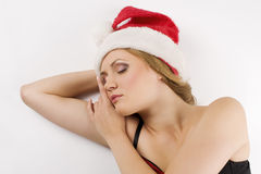 Sleeping girl portrait with santa claus hat Stock Images