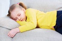 Sleeping girl on sofa. Stock Images