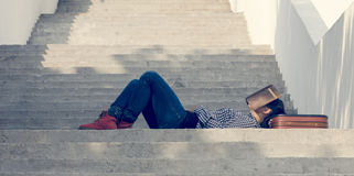 Sleeping girl on the stairs with book Royalty Free Stock Photo
