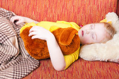 Sleeping girl with toy Royalty Free Stock Photo