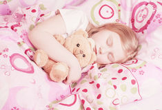 Sleeping girl with toy Royalty Free Stock Photography