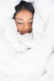 Sleeping girl wrapped up in her duvet Stock Photography