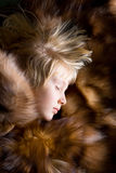 Sleeping girlie. On the fox fur royalty free stock photography