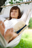 Sleeping on hammock. Young woman sleeping on hammock Stock Photography