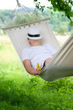 Sleeping on hammock. Young man sleeping on hammock Stock Image
