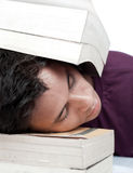 Sleeping with Head Between the Books Stock Photography