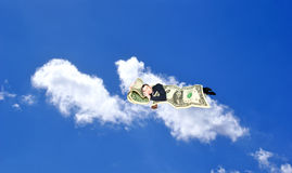 Sleeping upon heaven cloud businessman. Dreams of finance gain royalty free stock photo