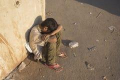 Sleeping homeless boy Royalty Free Stock Images