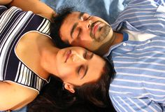 Sleeping Indian couple Royalty Free Stock Photography