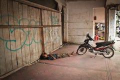 Sleeping Indonesian man and motorbike, Medan, Indonesia Royalty Free Stock Image