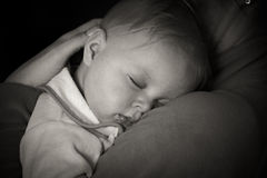 Sleeping infant. In mothers arms Royalty Free Stock Images