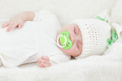 Sleeping infant baby girl dressed in bunny cap Stock Images