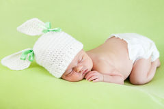 sleeping infant baby girl on green Royalty Free Stock Image