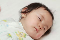 Sleeping Japanese baby girl. 0 year old stock photo