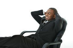Sleeping on the Job. Business man laying back and sleeping on the job Royalty Free Stock Images