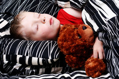 Sleeping kid. 4-5 years old boy in bed - sleeping time royalty free stock images