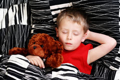 Sleeping kid. 4-5 years old boy in bed - sleeping time stock photography