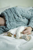 Sleeping kitten and owner Stock Photo