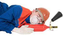 Sleeping laborer with fire extinguisheron Royalty Free Stock Photo