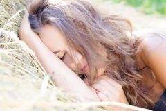 Sleeping lady on hay stack Royalty Free Stock Images