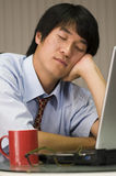 Sleeping on the laptop Stock Photography