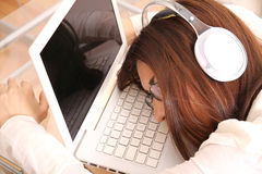 Sleeping on the Laptop Stock Photo