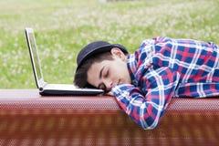Sleeping on the laptop Stock Image