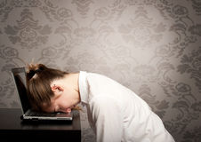 Sleeping on laptop Stock Photography