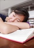 Sleeping in library. She is too tired Stock Photo