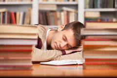 Sleeping at the library. Stock Photo