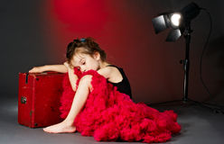 Sleeping little actress. On the stage royalty free stock photography