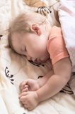 Sleeping little baby Stock Images