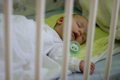 Sleeping babyboy with nipple stock photo
